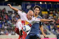 Luke Rodgers (9) of the New York Red Bulls is defended by Omar Gonzalez (4) of the Los Angeles Galaxy during a Major League Soccer (MLS) match at Red Bull Arena in Harrison, NJ, on October 4, 2011.