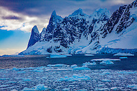 Inside Lemaire Channel, Antarctic Peninsula, Antarctica   Steep fjord between Booth Island and Mainland  Sunrise  Discovered 1873