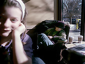 Morgan Slade spends a wintery Saturday inside Starbuck's in Princeton, New Jersey, while a patron relaxes. photo by jane therese