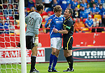 Aberdeen v St Johnstone... 23.07.11   SPL Week 1.Ref Steve Conroy separates Murray Davidson and David Gonzalez.Picture by Graeme Hart..Copyright Perthshire Picture Agency.Tel: 01738 623350  Mobile: 07990 594431