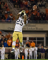 The eighth ranked Clemson Tigers defeat the Georgia Tech Yellow Jackets at Death Valley 55-31 in an ACC matchup.  Georgia Tech Yellow Jackets running back Robert Godhigh (25) misses a pass