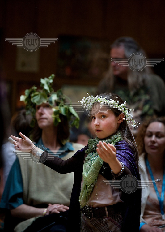 A young girl taking part in the opening cermony of the Beltane Bash Pagan Beltane celebrations in Conway Hall, Bloomsbury, London.