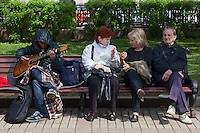 Moscow, Russia, 15/05/2012..Local residents chat as a protester plays a guitar in Chistiye Prudy, or Clean Ponds, as a Moscow court ordered the eviction of some 200 opposition activists who have set up camp in the city centre park.
