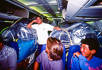 Brad Gerlach (USA) on the infamous charter flight between Reunion Island and Durban, South Africa.  The contest in Reunion Is had run over time and the Gunston 500 was due to start and the only way everyone could get there in time was a charter flight. The flight was late taking off form Reunion Is and turned into one giant party which has made it into pro surfing folklore.  circa 1991 Photo: joliphotos.com
