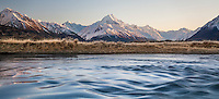 Winter sunrise looking across the Tasman River towards Aoraki / Mt Cook covered in snow, Mackenzie Country, Canterbury, New Zealand (Panorama)