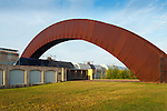 Piety Street Arch (the 'rusty rainbow') is an elevated pedestrian bridge that crosses over active railroad tracks to Crescent Park in the Bywater neighborhood of New Orleans.