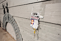 Street art enthusiasts flock to the Williamsburg neighborhood of Brooklyn in New York on Thursday, October 17, 2013 to see the seventeenth installment of Banksy's graffiti art. The elusive street artist is creating works around the city each day during the month of October. A flyer for missing autistic teen, Avonte Oquendo, is posted next to the artwork.(© Richard B. Levine)