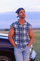 man leaning against a truck on a ranch in New Mexico