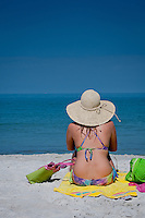 Girl on beach with a hat in swimsuit gulf of mexico at for Fishing mexico beach fl