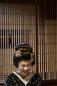Rinka, one of three trainee geisha, known as 'maiko' until they make their debut appearance, who have been hired and are being trained by the local authorities in Shimoda, Japan, on Wednesday 14th December 2011. .The three geisha are Awagiku (in white/silver kimono), Rinka (black kimono), Iroha (pink kimono). Their teachers are Nami (green kimono), Hanamaru (geisha in purple kimono) and their teacher of shamisen musical instrument is Chikako (wearing pink kimono, gold glasses)..The three trainee geisha were selected after applying for the positions which were advertised by Shimoda city council via the 'Hello Work' employment office. The Shimoda city council hope to keep the geisha tradition alive within their town by the appointment of the girls, and the girls will undertake geisha duties at local festivals and for tour groups and tourists.