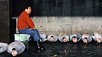 A tired worker sits in the morning sun, yawns at Tsukiji Fish Market in Tokyo, Japan where a skilled army of licensed middlemen and buyers purchase tuna and a variety of seafood for sale in the market's 1,400 shops. Because of the Japanese passion for freshness, all the fish sold will be consumed by Tokyo residents the following day. (Jim Bryant Photo).....
