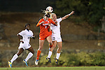 20 October 2013: Clemson's Paige Reckert (8) and North Carolina's Caitlin Ball (2) challenge for a header. The University of North Carolina Tar Heels hosted the University of Virginia Cavaliers at Fetzer Field in Chapel Hill, NC in a 2013 NCAA Division I Women's Soccer match. North Carolina won the game 2-0.