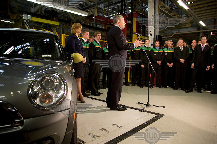 Prime Minister and Labour Party leader Gordon Brown, supported by his wife Sarah and Energy Secretary Ed Miliband, speaking at an election campaign stop at the BMW Mini car plant in Oxford.