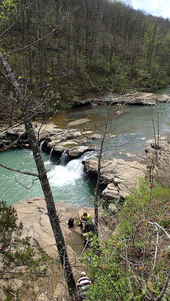 NWA Democrat-Gazette/FLIP PUTTHOFF <br /> It's easy to climb a riverside bluff    April 14 2017   for an up-high view of the waterfall.