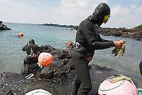 Skin diving haenyo (sea woman) matriarch  - JeJu Island - South Korea