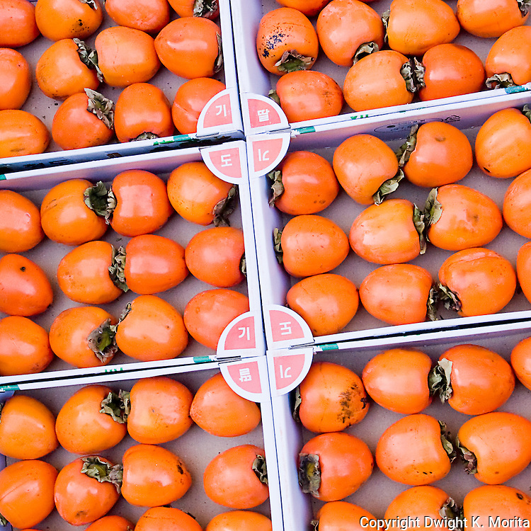 Persimmons await in crates at a market in Wonju, Korea