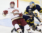 Chris Kreider (BC - 19) falls back over Karl Stollery (Merrimack - 7). - The Boston College Eagles defeated the visiting Merrimack College Warriors 3-2 on Friday, October 29, 2010, at Conte Forum in Chestnut Hill, Massachusetts.