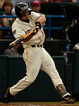 06/17/2006 Oregon State's Darwin Barney makes contact during game 4 of the College World Series in Omaha Nebraska Saturday evening..(photo by  Chris Machian/Prairie Pixel Group)