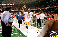 Green Bay Packer defensive end Reggie White makes a lap around the Superdome with the Lombardi Trophy after the Green Bay Packers defeated the New England Patriots 35-21 in Super Bowl XXXI on January 26, 1997.