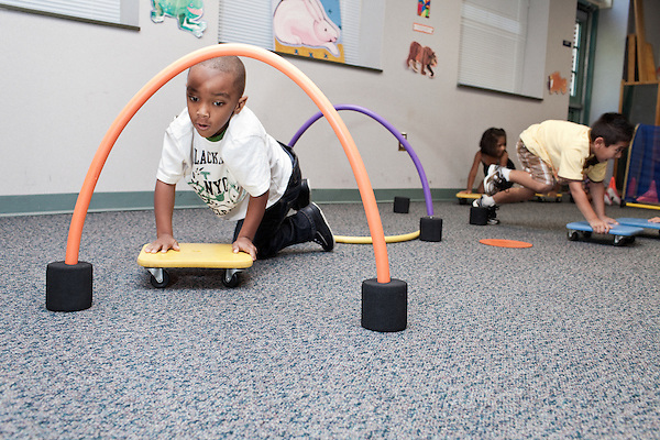 September 14, 2011. Raleigh, NC. . Zaire Hines zips through a foam arch in the movement class.. Project Enlightenment, a public pre-kindergarten program for at risk children, has been threatened with closure due to state wide budget cuts..