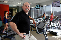NWA Democrat-Gazette/DAVID GOTTSCHALK - 1/21/15 - Stu Walker, founder and owner of Clubhause Fitness, at the boutique gym on Dickson Street in Fayetteville Wednesday January 21, 2015.