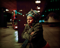 """20 year old Thania, from DR Congo, at London's Euston Station where she spent a year sleeping rough. She arrived in the UK in September 2004 claiming asylum after her family were murdered by Congolese soldiers. She was forced to watch her brother burned to death after a tyre was set alight around his neck. She was raped but managed to escape. After her claim was refused she walked the streets begging people for food and money, """"I couldn't think properly because I was so hungry."""" Thania is one of an estimated 300,000 rejected asylum seekers living in the UK. ."""