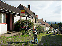 BNPS.co.uk (01202 558833)<br /> Pic: RachelAdams/BNPS<br /> <br /> Pictured - Jamie Park, 5, from Shaftesbury pushes his scooter up Gold Hill<br /> <br /> A cottage immortalised in the famous Hovis TV advert featuring a young boy struggling to push his bike up a steep cobbled street is up for sale.<br /> <br /> The bungalow at Gold Hill, Shaftesbury, Dorset, was the home of 'Old Ma Peggotty' in the ad - the last house on the bakery boy's round.<br /> <br /> The 1973 commercial, directed by Ridley Scott, was voted Britain's all-time favourite TV advert in 2006.<br /> <br /> In it the lad is heard to say that delivering bread to the house on top of the hill 't'was like taking bread to the top of the world.'