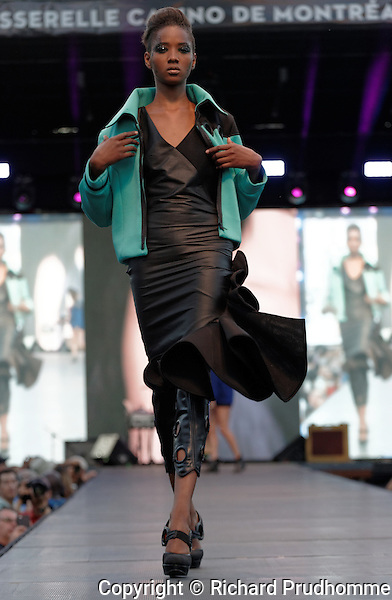 A model walks on the runway at the Rob Chamaeleo fashion show held during the Fashion and Design Festival  in downtown Montreal.