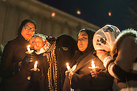 Nida Allam (second from left), a senior at North Carolina State University, is comforted by Arsheen Allam as thousands gathered for a vigil and memorial for three shooting victims at The Pit at The University of North Carolina at Chapel Hill in Chapel Hill, North Carolina on Wednesday, February 11, 2015. Craig Hicks, 46, of Chapel Hill has been charged with three counts of first-degree murder in the killings of Deah Barakat, 23, a UNC student; his wife, Yusor Abu-Salha, 21; and her sister, Razan Abu-Salha, 19. (Justin Cook)
