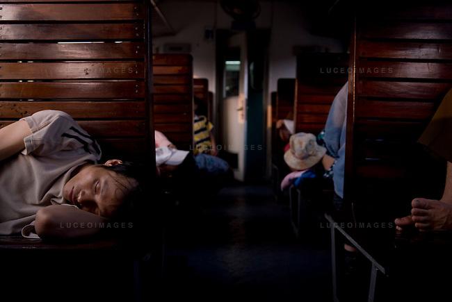 Passengers sleep on a train from Hanoi to Sapa, Vietnam.