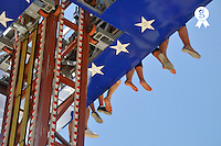 Hanging kids legs, at amusement park (Licence this image exclusively with Getty: http://www.gettyimages.com/detail/90430495 )