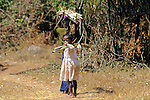Young Girl Carrying Cane