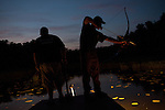 Mike Brookover, left, the owner and operator of Precision Wildlife Nuisance Control, and Matt Wroe, right, bow fish on Aquia Creek, near Stafford, Virginia on June 20, 2013. CREDIT: Lance Rosenfield,