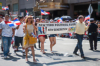 Members of a political club march in the Dominican Day Parade in New York on Sixth Avenue on Sunday, August 11, 2013.  Politicians, flags and cultural pride were on display at the annual event.  (© Richard B. Levine)