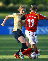 Sam Mewis (USA) defends the ball as Alexandra Popp (GER) takes the ball up field..FIFA U17 Women's World Cup, Semi Final, Germany v USA, QEII Stadium, Christchurch, New Zealand, Thursday 13 November 2008. Photo: Renee McKay/PHOTOSPORT