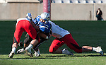 Mustang Running back Jonathan Johnson is stooped by a pair of Cavalier defenders. The Friendswood Mustangs lost to the Lake Travis Cavaliers 24 - 3 at Kyle Field on December 11, 2010 in the Class 4A, D-1 state semifinals.