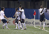 USA players celebrate after Josmer Altidore's (far right) second goal. USA stunned Brazil, winning 2-1 to finish first in their group. Final game in group D in Ottawa, Ontario, on JULY 6 2007.