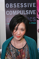 Woman wears Obsessive Complusive Cosmetics, at the Makeup Show NYC, in the Metropolitan Pavilion, May 15 2011.