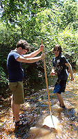 NWA Democrat-Gazette/FLIP PUTTHOFF <br /> Charles Nystrom holds the net while Dale Smith shuffles his feet in the water to dislodge      July 2016     aquatic insects from the gravel stream bed.