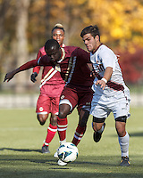 Boston College midfielder/defender Atobra Ampadu (6) and Virginia Tech forward Daniel Lauretano (30) battle for the ball. Boston College (maroon) defeated Virginia Tech (Virginia Polytechnic Institute and State University) (white), 3-1, at Newton Campus Field, on November 3, 2013.