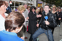13/10/2010. Crystal Swing Busking. Fans dance with Derek Burke from Cork band Crystal Swing as they launch the busking contest outside the Gaiety Theatre, Dublin for the Mooney radio show on RTE. Picture James Horan/Collins Photos