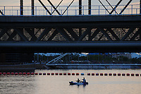 Tempe, Arizona. Two people on a kayak go under the Light Rail bridge on Tempe Town Lake at sunset. Kayaking on the lake occurs throughout the year. Photo by Eduardo Barraza © 2015