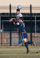 Tommy Muller (8) of Georgetown goes up for a header with Sergio Lopez (15) of San Diego during the game at North Kehoe Field in Washington, DC.  Georgetown defeated San Diego, 3-1.