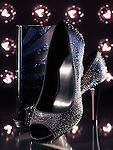 Product still life of luxurious black high heel shoes with shiny rhinestones and a handbag