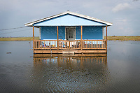 A house in the community of Isle Jean Charles, Louisiana pictured after hurricanes Gustav and Ike hit the coast of Louisiana. Residents of the town were forced by authorities to evacuate and most residents lost the entire contents of their homes. Increasingly frequent flooding and storm damage due to massive coastal erosion plague the Native American population who lives here with yet another diaspora.