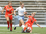 24 September 2006: Miami's Kristen Chapman (9) tackles the ball away from UNC's Caroline Boneparth. The University of North Carolina Tarheels defeated the University of Miami Hurricanes 6-1 at Fetzer Field in Chapel Hill, North Carolina in an NCAA Division I women's soccer game.