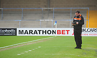 Blackpool manager Gary Bowyer stands in the dugout reading the match day programme<br /> <br /> Photographer Kevin Barnes/CameraSport<br /> <br /> The EFL Sky Bet League Two - Wycombe Wanderers v Blackpool - Saturday 11th March 2017 - Adams Park - Wycombe<br /> <br /> World Copyright &copy; 2017 CameraSport. All rights reserved. 43 Linden Ave. Countesthorpe. Leicester. England. LE8 5PG - Tel: +44 (0) 116 277 4147 - admin@camerasport.com - www.camerasport.com