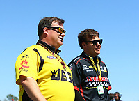 Mar 17, 2017; Gainesville , FL, USA; NHRA pro mod driver Troy Coughlin (left) and son top fuel driver Troy Coughlin Jr during qualifying for the Gatornationals at Gainesville Raceway. Mandatory Credit: Mark J. Rebilas-USA TODAY Sports
