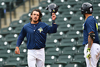 Designated hitter Jay Jabs (7) of the Columbia Fireflies is congratulated by Ali Sanchez after scoring a run in a game against the Lexington Legends on Sunday, April 23, 2017, at Spirit Communications Park in Columbia, South Carolina. Lexington won, 4-2. (Tom Priddy/Four Seam Images)