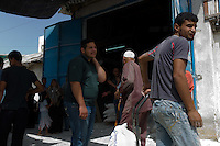 Gaza City, June 6, 2010.A UN food distribution. Since the beginning of the 2007 Israeli blockade of Gaza, more than 80% of its million and a half inhabitants are dependent of foreign food aid.